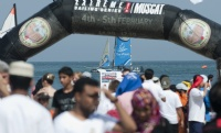 Thousands gather on the beach on the first public day of the Muscat event